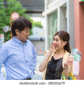 handsome couple shopping at a street
