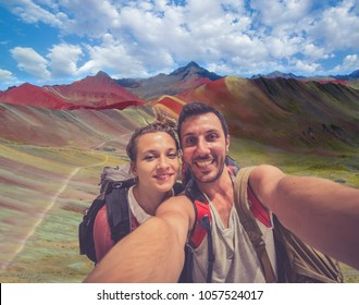 handsome couple take selfie photo at  Rainbow mountains near Cuzco, Peru