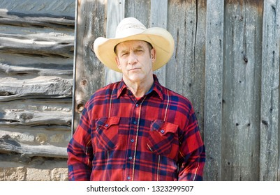 Handsome cowboy or rancher with a skeptical expression