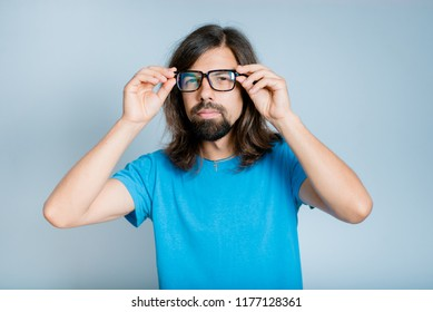 handsome curious man with glasses, isolated studio photo on background