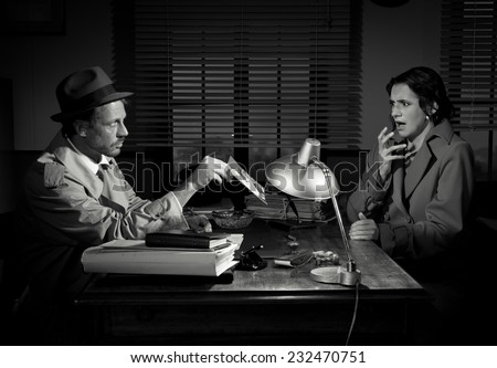 Handsome detective office desk showing picture stock photo edit now