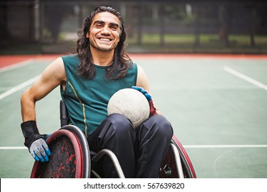 handsome determined disabled rugby player in a wheelchair on a stadium