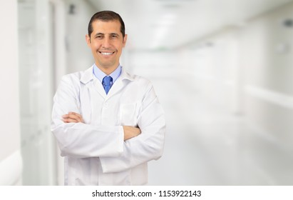 c7519b35e95 A handsome doctor standing with his arms folded and smiling at the camera