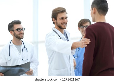 handsome doctor talking with the patient