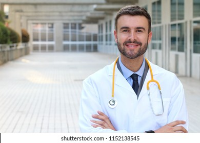 Handsome doctor wearing withe coat