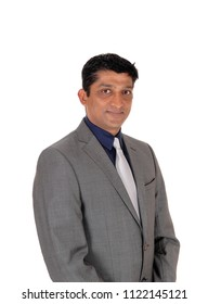 A handsome east Indian businessman in a gray suit and black hair