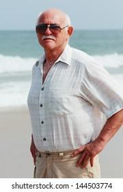 handsome elderly man on the beach