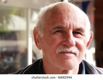 handsome elderly man in the street. portrait