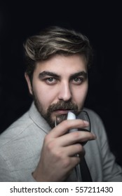 Handsome elegant man a glass of wine
