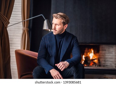 Handsome elegant man looking out of the window