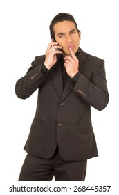handsome elegant young latin man wearing a suit posing talking on cell phone mobile isolated on white
