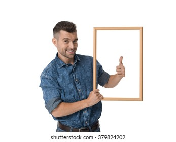 Handsome emotional Man posing with frame Portrait Isolated on White Background