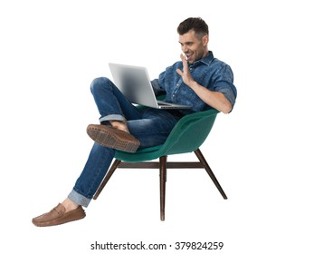 Handsome emotional Man sitting on armchair and using laptop Portrait Isolated on White Background