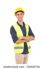 Handsome engineer smiling and standing confidently, guy wearing blue shirt and beige pants with a yellow vest and yellow helmet, isolated on white background