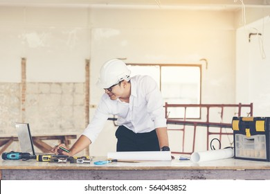 Handsome engineer working in construction site. construction concept.