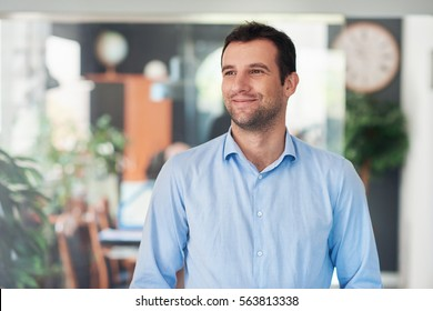 Handsome entrepreneur thinking up new business ideas
