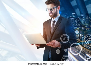 Handsome european businessmam using laptop with abstract business hologram. Technology and media concept. Double exposure