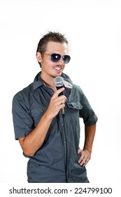 Handsome european singer wearing sunglasses on the white background
