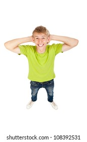 handsome excited free man happy smile looking at camera, hold hands on head freedom top angle full length portrait above view young guy wear green t shirt, white teeth, isolated over white background