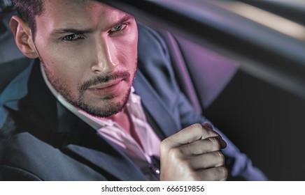 Handsome fashion man driving a car