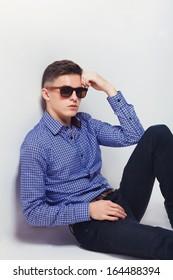 handsome fashion man wearing sunglasses thinking