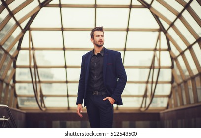 Handsome fashion model in a blue suit