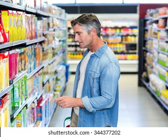 Handsome father doing some shopping at supermarket