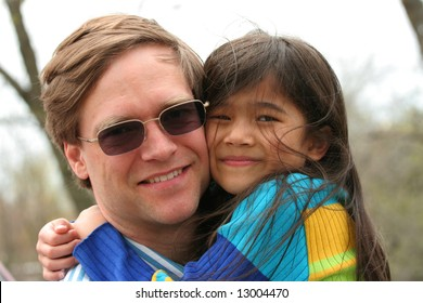 Handsome father holding his little girl