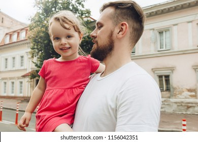 Handsome father holding little daughter