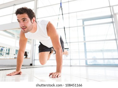 Handsome fit man exercising a the gym