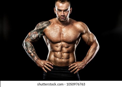 ccf99405b Handsome fit man posing wearing in jeans with tattoo. Sport and fashion  concept isolated on