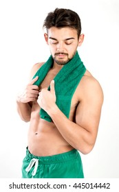 Handsome and fit young man with great abs posing with a towell
