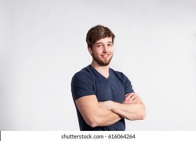Handsome fitness man in gray t-shirt, studio shot.