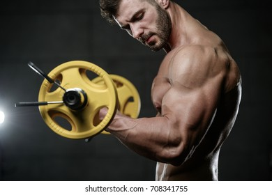 Handsome fitness model train in the gym gain muscle healthcare lifestyle sexy caucasian man bodybuilder work out naked body on diet