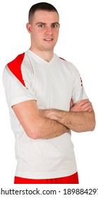 Handsome football player looking at camera on white background