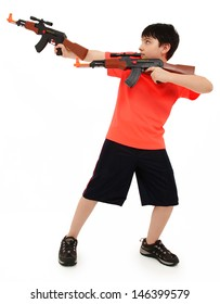 Handsome French American Boy Aiming Two  Plastic Toy AK47 To Side