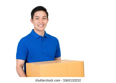 Handsome friendly smiling Asian delivery man  in blue polo shirt carrying parcel box, studio shot isolated on white background