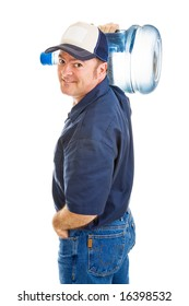 Handsome, friendly water delivery man carrying a 5 gallon jug on his shoulder.  Isolated on white.