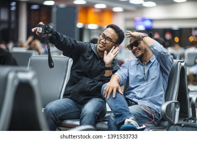 Handsome friends making selfie and smiling