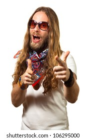 Handsome and funny man dressed like a hippie pointing towards the camera. Isolated on white.
