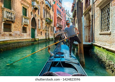 Handsome gondolier during gondola ride on the street of Venice, Italy