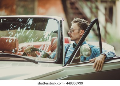 Handsome groom in the car