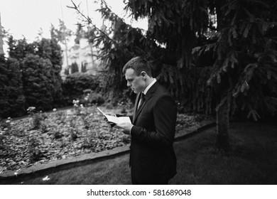Handsome groom in the garden