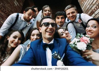 Handsome groom selfie with fun beautiful bridesmaids & groomsmen
