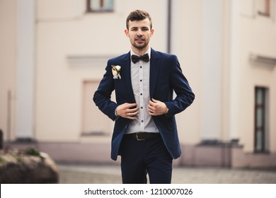 Handsome groom at wedding smiling and waiting for bride man. Happy smiling groom newlywed. Rich man at wedding day. Elegant groom in tuxedo costume. Handsome caucasian man in tuxedo.