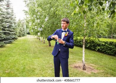 Handsome groom at wedding tuxedo.