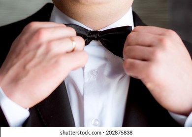 Handsome groom at wedding tuxedo smiling and waiting for bride. Happy smiling groom newlywed. Rich groom at wedding day