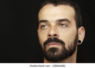 Handsome guy with beard on black background