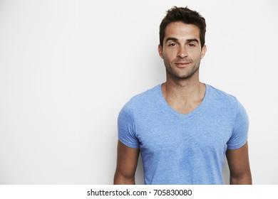 Handsome guy in blue t-shirt in studio