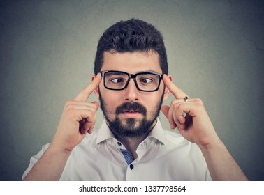 Handsome guy in glasses with strabismus